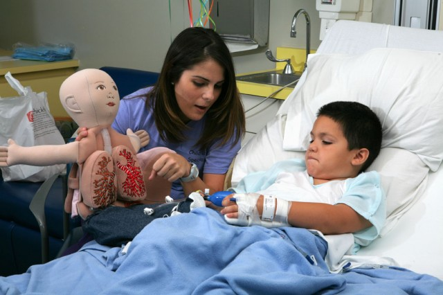 Respiratory Therapist treating a patient at Driscoll Children's Hopsital