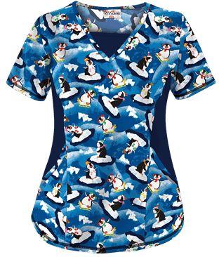 Uniform Advantage's holiday scrub prints - UA Chilling Out Penguins Royal Print Scrub Top