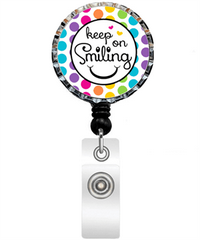 Keep On Smiling Bottle Cap Badge Reel
