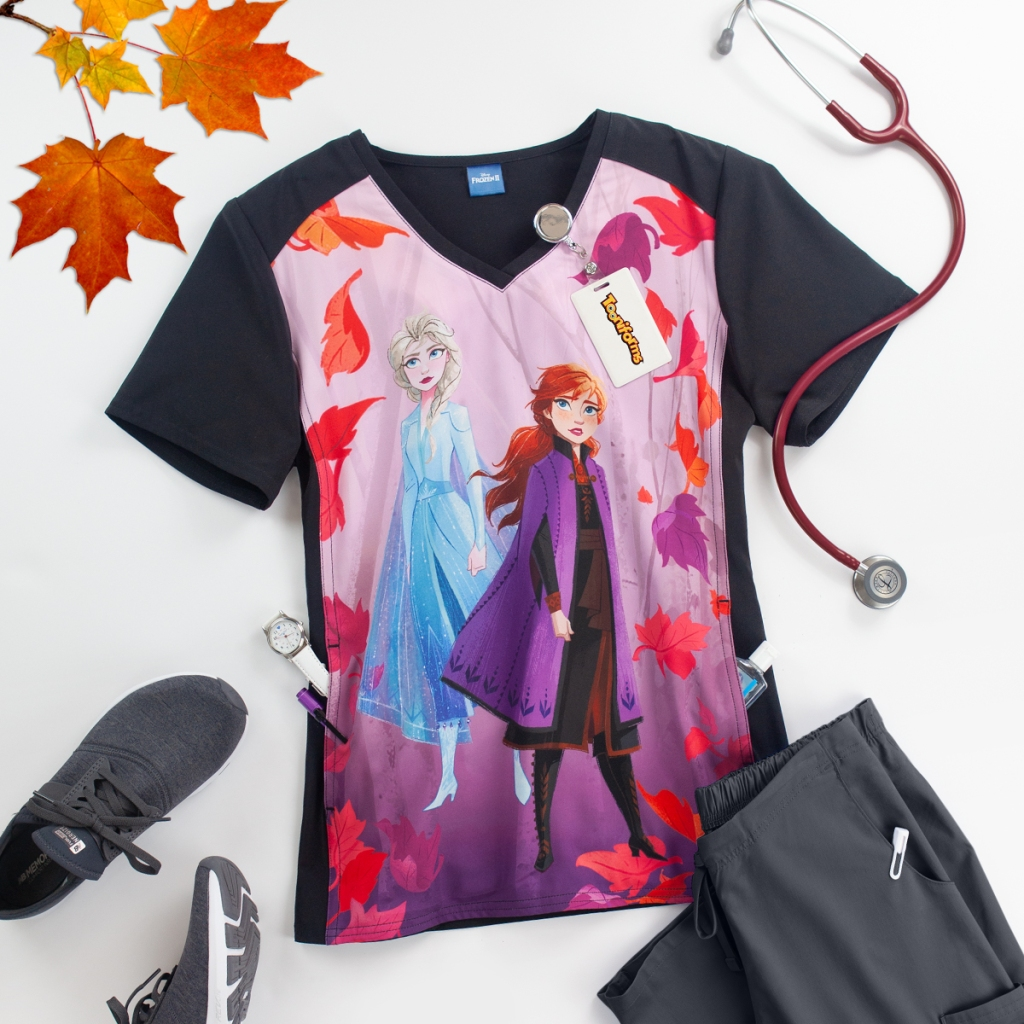 Channel your inner Anna or Elsa with Cherokee Tooniforms Disney Frozen 2 V-Neck Print Scrub Top. It has a kangaroo pocket, front and back princess seams, side darts and is made out of 95/5 poly/spandex poplin.