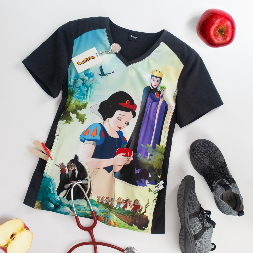 The Cherokee Tooniforms Disney Enchanted V-Neck Print Scrub Top showcases Snow White and the Evil Queen from the movie Snow White and the Seven Dwarves. This cute top also has a kangaroo pocket, side slits, princess seams and has a fabric content of 95/5 poly/spandex poplin.
