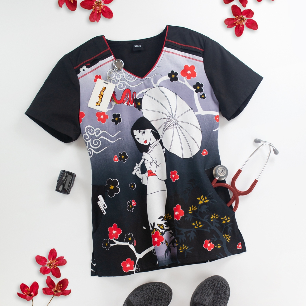 There's no doubt that wearing this Cherokee Tooniforms Disney Mulan and Mushu V-Neck Print Scrub Top will bring honor to us all. Enjoy the red piping along the neckline, two side pockets, side slits and a 100% cotton fabric content.