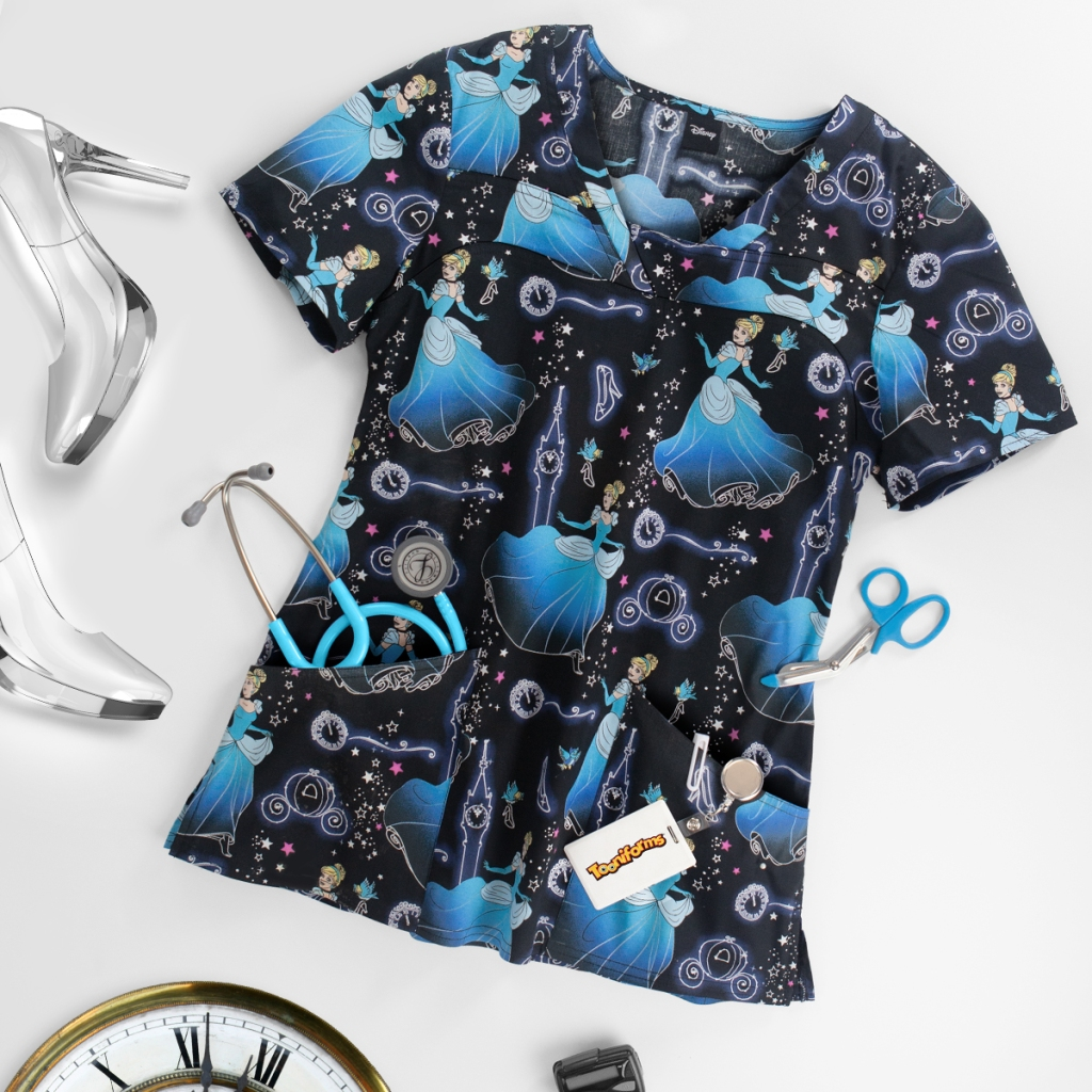 What happens to you when the clock strikes midnight? The Cherokee Tooniforms Disney Stroke of Midnight V-Neck Print Scrub Top features Disney's Cinderella. Made of 97/3 cotton/spandex poplin, this princess top also includes 2 angled front pockets, a modified v-neck, back darts and side slits.