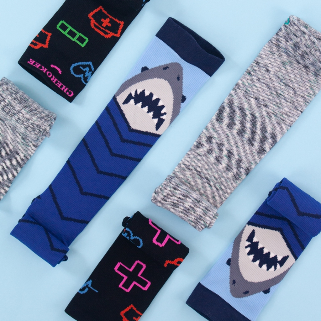 Cherokee Print Shark Attack Support Men's Socks are a great gift to the special superhero in your life. These socks have a 8-12 mmHg gradient compression, and a fabric content of  90/10 textured nylon/Lycra