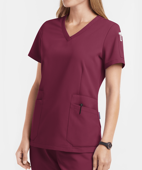 Healthcare worker in wine scrubs