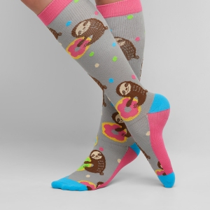 The Think Medical UA exclusive socks showcases fun colors, cute sloths and a dessert favorite! The socks have a 10-14 mmHg gradient compression and a fabric content of 90/8/2 nylon/elastic/spandex.